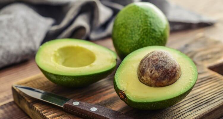 Avocado cut in half with pit