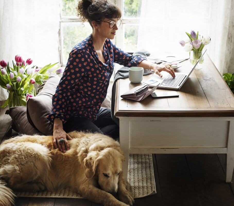 Women pets ESA dog at desk